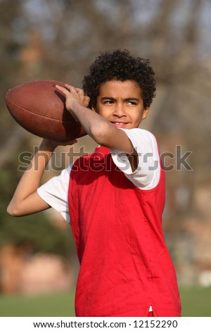 African American boy playing a football - stock photo