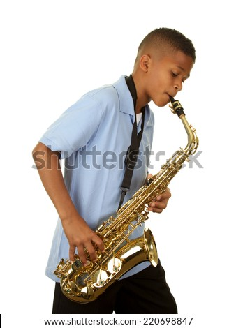 African American boy playing the saxophone on a white background - stock photo
