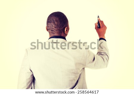 African american business man writing something with marker. - stock photo