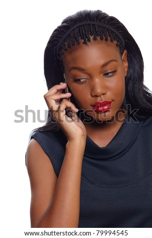 African American business woman listens seriously on the cellphone over white background - stock photo
