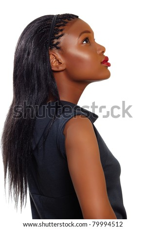 African American business woman looking up in profile over white background - stock photo