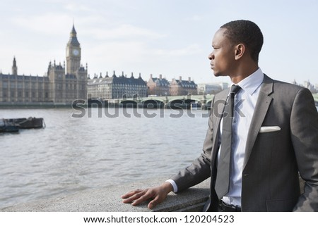 African American businessman looking at buildings - stock photo