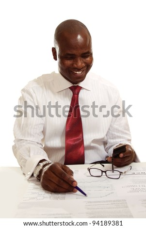African American businessman reading a newspaper, isolated on white - stock photo