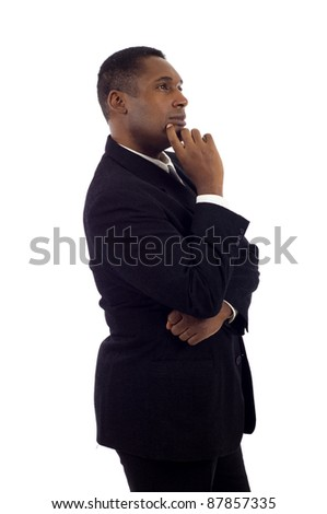 African American businessman standing on white background, looking off into distance - stock photo