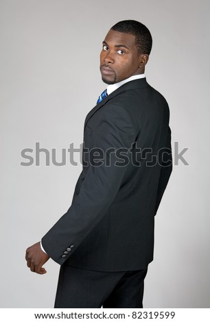 African American businessman turning and looking back. - stock photo