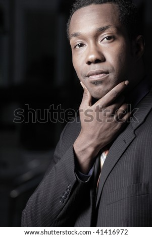 African American businessman with his hand on his chin - stock photo