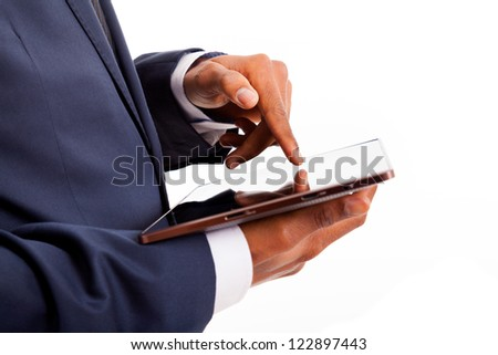 African American businessman working on a digital tablet, isolated - stock photo