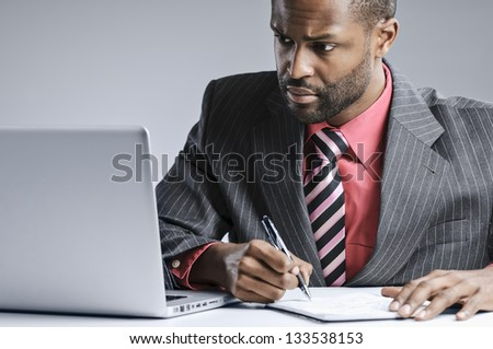 African American Businessman Working On His Laptop - stock photo