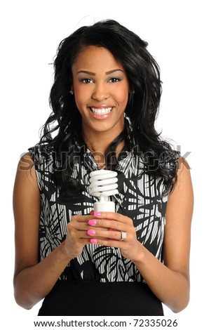 African American businesswoman holding fluorescent bulb isolated over white background - stock photo