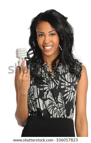 African American businesswoman holding fluorescent light bulb isolated over white background - stock photo