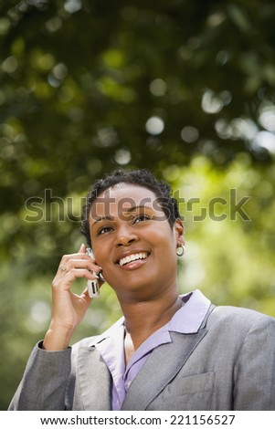 African American businesswoman talking on cell phone - stock photo