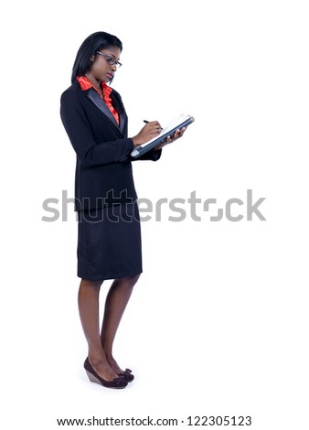 African American businesswoman writing on clipboard over white background - stock photo