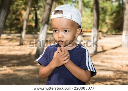 African American child boy in park on nature at summer. Use it for baby, parenting or love concept - stock photo