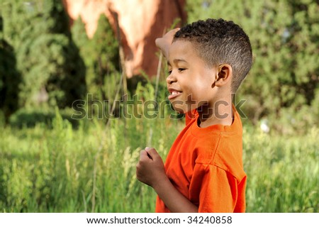 African American Child in a meadow - stock photo