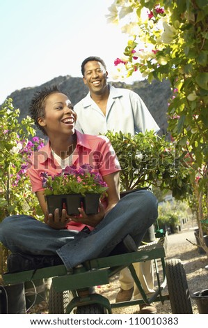 African American couple enjoying at a botanical garden - stock photo