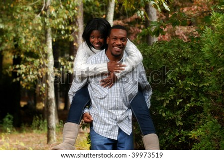 African-American couple enjoying the outside fall weather - stock photo