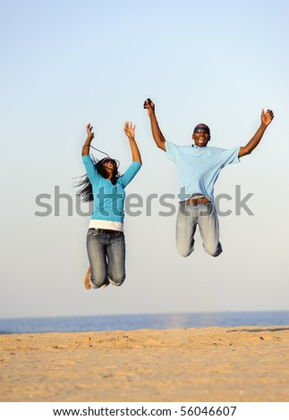 African American couple having fun at the beach - stock photo