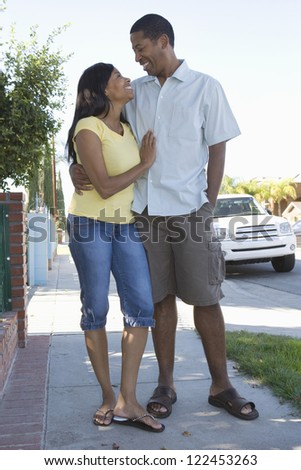 African American couple standing together outdoors - stock photo