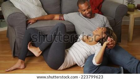 African American couple talking on floor - stock photo