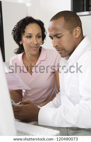African American couple worried about domestic bill - stock photo