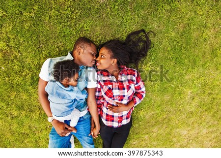 african american family on a perfect green lawn - stock photo