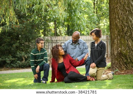 African American family outdoors - stock photo