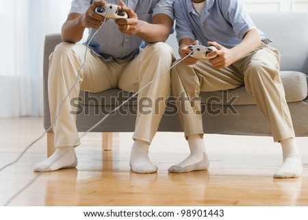 African American father and son playing video games - stock photo