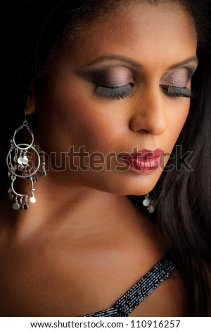 African American Female Model Portrait Low Key Eyes Closed - stock photo