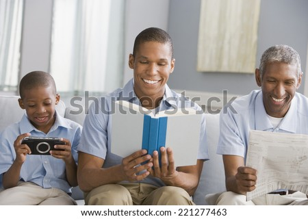 African American grandfather, father and son relaxing - stock photo
