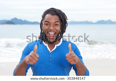 stock-photo-african-american-guy-with-dreadlocks-at-beach-showing-both ...
