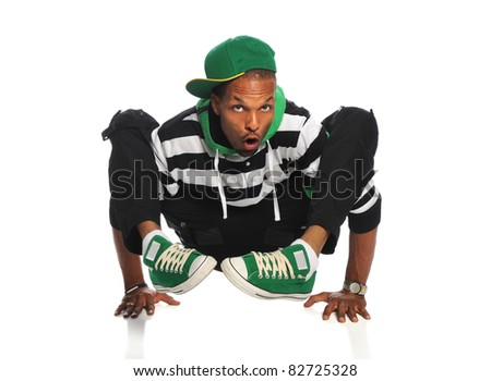 African American hip hop dancer balancing on hands isolated over white background - stock photo