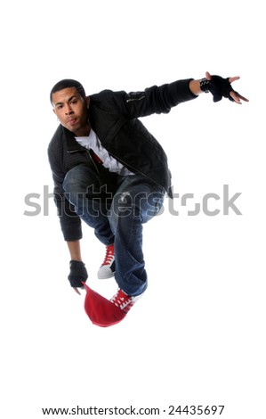 African American hip hop dancer jumping over baseball hat - stock photo