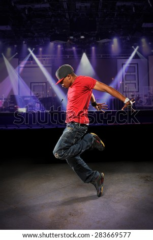 African American hip hop dancer performing indoors - stock photo