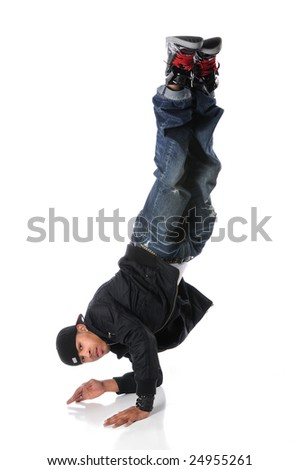 African American hip hop dancer performing with legs up - stock photo