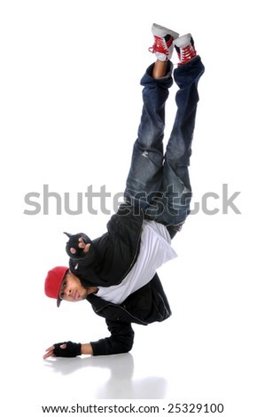 African American hip hop dancer standing on one arm - stock photo