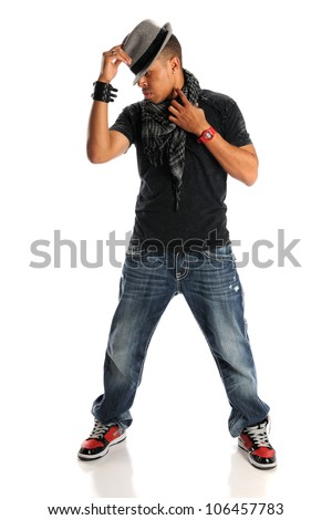 African American hip hop dancer tipping hat standing isolated over white background - stock photo