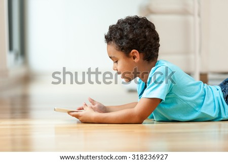 African american little boy using a tactile tablet - stock photo