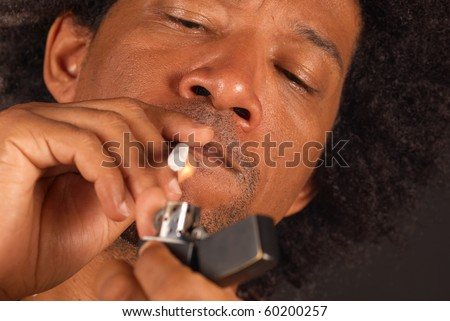 African american male about to light a spliff - stock photo