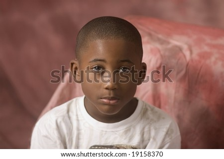 african american male child looking directly at camera  without smiling - stock photo