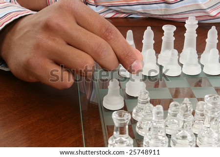 African american male hand on glass chess piece. - stock photo
