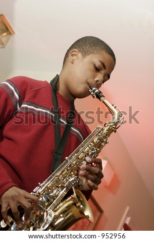 african american male teen playing saxophone - stock photo