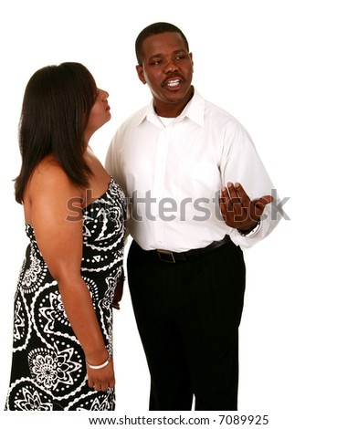 african american man communicate with his hand to his wife trying to explain thing - stock photo
