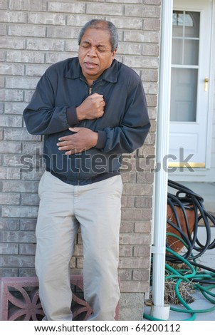 African american man having a heart attack. - stock photo