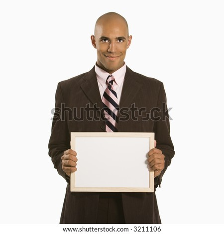 African American man holding blank sign standing against white background. - stock photo