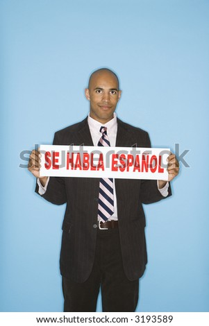 African American man holding sign reading se against blue background. - stock photo
