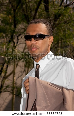 African American man in business wear and sun glasses - stock photo