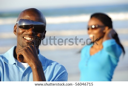 African American man is happy at the beach - stock photo