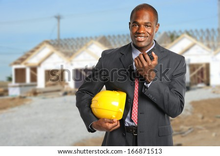 African American manager at construction site using radio - stock photo