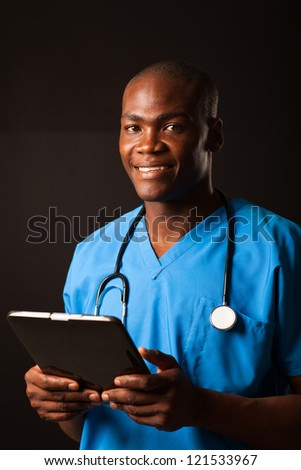 african american medical doctor with tablet computer - stock photo