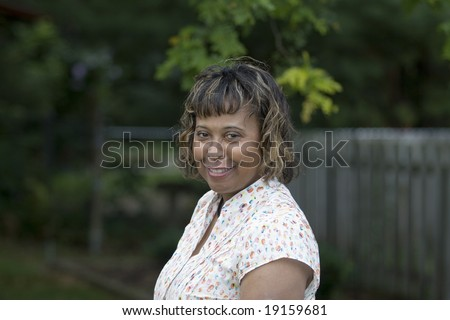 african american middle aged woman summer outdoor portrait - stock photo